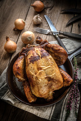 Roasted chicken on plate.