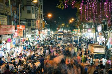 CROWD ON mumbai CITY STREET AT NIGHT