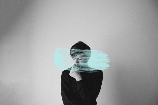 Digitally Generated Image Of Brush Stroke Against Thoughtful Man