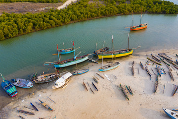 Aerial view of colourful Pirogues and fishing boats at the beach in Morondava, Madagascar