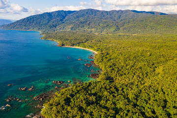 Aerial view of remote beach squeezed between coral reef and primary rainforest, Tampolo, Masoala National Parl, Madagascar