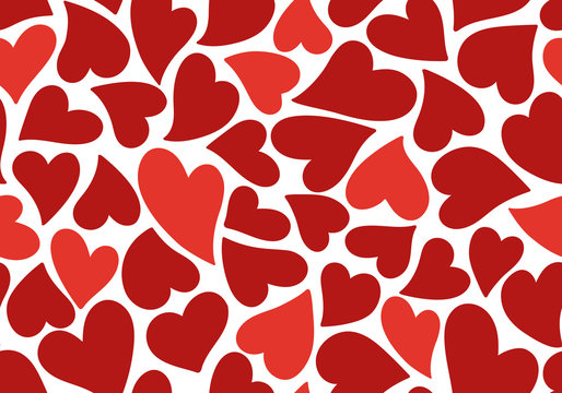 Seamless pattern of simple red hearts isolated on white for wrapping paper or fabric. Hand drawn style. Vector illustration.