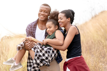 African American Family Looking very Happy outdoors.