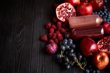 Mix of fresh red and black fruits. With botteled fresh juices