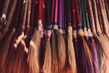 Full Frame Shot Of Brooms