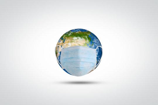 Coronavirus/ corona virus concept. World or earth put mask to fight to fight against coronavirus. Concept of fight aginst virus and world pollution
