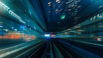Blurred Motion Of Illuminated Railroad Tracks At Night