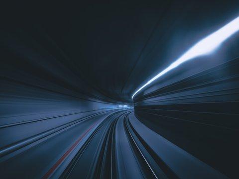 Light Trail In Illuminated Tunnel