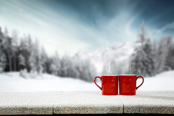 Fototapete - Wooden table cover of frost and snow with Valentine's Day coposition.Copy space for your product and winter landscape of mountains.