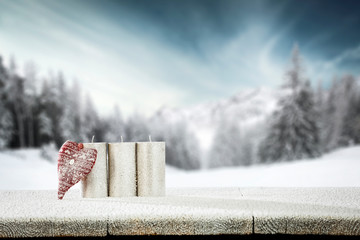 Wall Mural - Wooden table cover of frost and snow with Valentine's Day coposition.Copy space for your product and winter landscape of mountains.