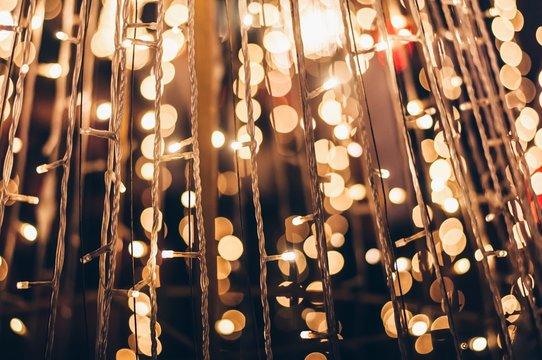 Full Frame Of Illuminated Light Bulb Hanging At Night