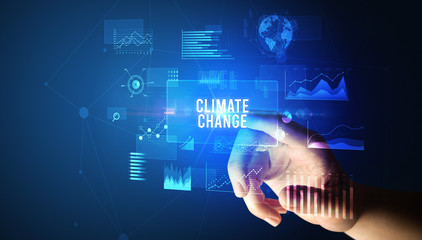 Hand touching CLIMATE CHANGE inscription, new business technology concept