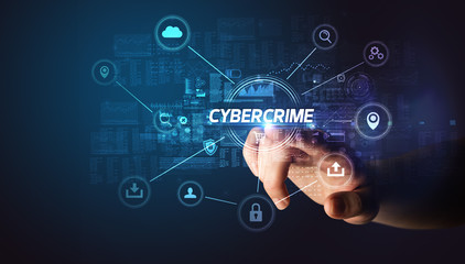 Hand touching CYBERCRIME inscription, Cybersecurity concept