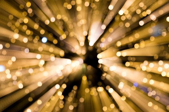 DEFOCUSED IMAGE OF ILLUMINATED LIGHT BULBS