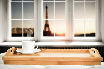 Wall Mural - Wooden desk with window and coffee background.