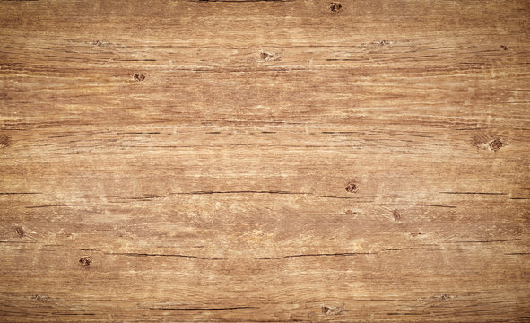 Wood texture background., vintage wooden table with cracks and knotts. Light brown surface of old wood with natural color and pattern.
