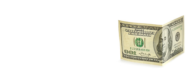 American dollars isolated on white background. Free space for text. Wide photo.