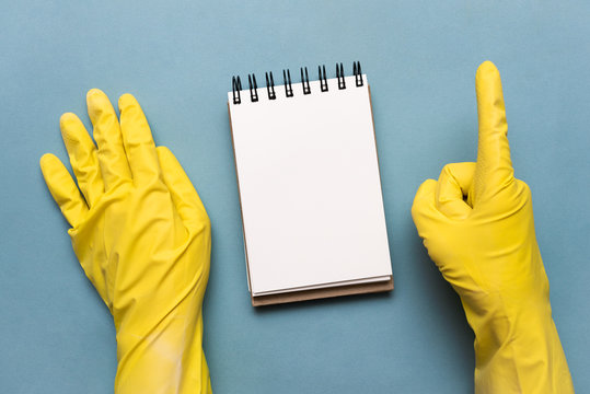 Blank page notepad with copy space over blue background. Washing tips or to do list template.
