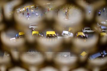 City Street Seen Through Fence