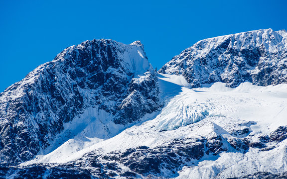 View of glacier winding its way from the top of a mountain Alaska