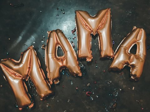High Angle View Of Mama Text Helium Balloons On Floor