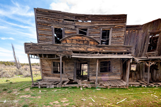 Wooden building in a town from the wild west starting to fall