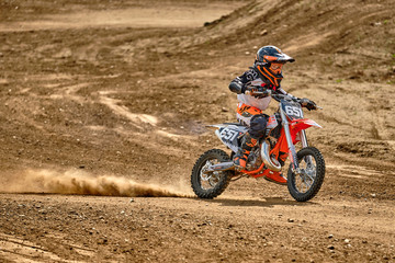 A child at a motocross training session in Moscow at the Technical Sports Stadium