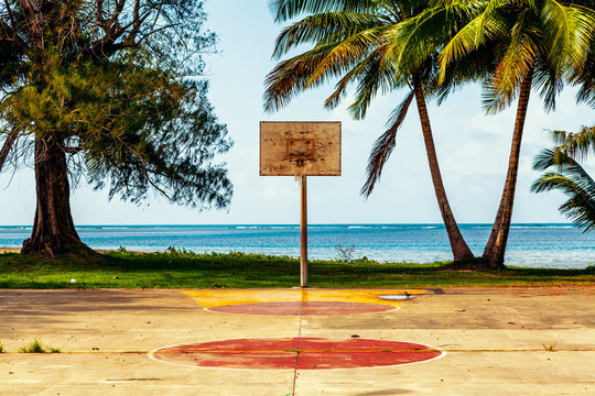 Basketball Court With Ocean and Palms in Background