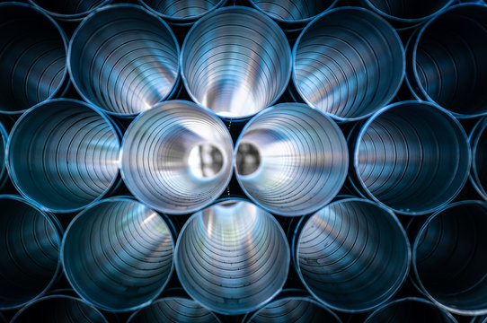 Large Silver Pipes Stacked At Factory