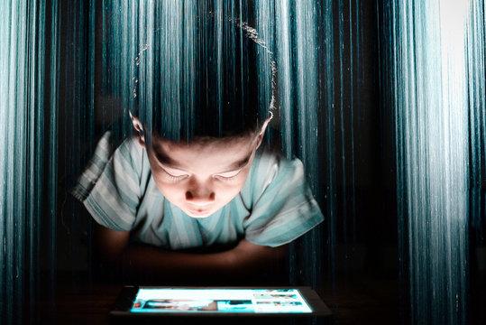 Double Exposure Of Boy Looking At Digital Tablet