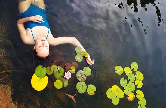 High Angle View Of Mid Adult Woman Relaxing In Lake