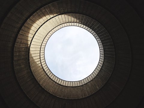 LOW ANGLE VIEW OF cooling tower of nuclear power plant AGAINST SKY