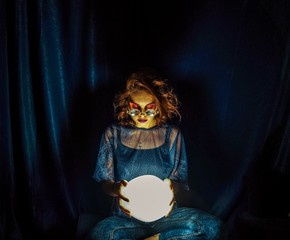 Fortune Teller Holding Illuminated Crystal Ball