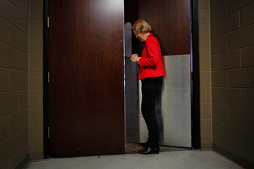 Democratic 2020 U.S. presidential candidate Warren waits backstage as she is introduced in Bettendorf