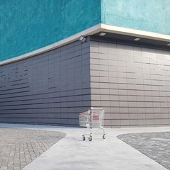 Shopping Cart On Footpath Against Building