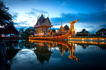 Fotobehang Bedehuis A huge Thai Suphannahong, also called Golden Swan or Phoenix boat at the WatpahSuphannahong Temple sunlight day time in sisaket, Thailand