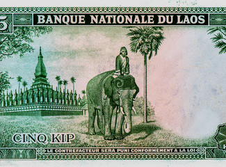 Wall Murals Chicken Temple, elephant rider. portrait from Laos 5 Kip 1962 banknote. An Old paper banknote, vintage retro. Famous ancient Banknotes. Laos money. Laos Banknote. Collection..