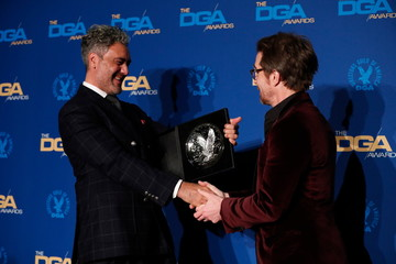 """Taika Waititi, director of """"Jojo Rabbit"""" poses with Sam Rockwell while holding his nominee medallion at the 72nd Annual Directors Guild Awards in Los Angeles"""