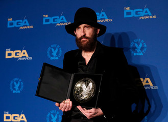 """Johan Renck, director of """"Chernobyl"""" poses with his winning medallion for Outstanding Directorial Achievement in Movies for Television and Limited Series, at the 72nd Annual DGA Awards in Los Angeles,"""
