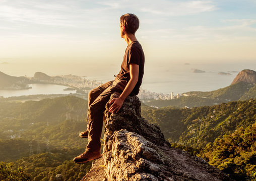 Full Length Of Man Looking At View Of Mountains