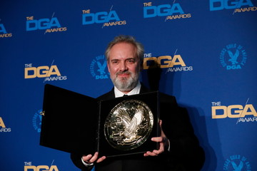 """Sam Mendes, director of """"1917"""", holds his winning medallion for Outstanding Directorial Achievement in Theatrical Feature Film category at the 72nd Annual Directors Guild Awards in Los Angeles,"""