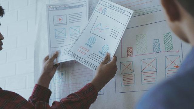 Designers man drawing (UX) (UI) Graphic designer creative sketch planning application process development prototype for responsive web desig