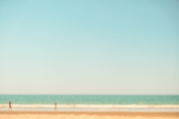Wall Mural - Abstract background of blurred beach and sea waves. In the summer vacation. vintage filter.