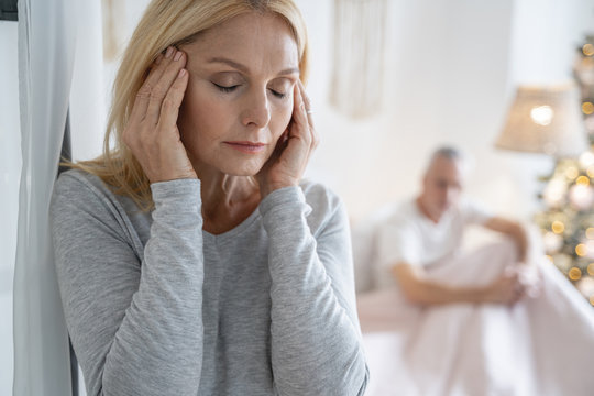 Terrible headache of woman at home stock photo