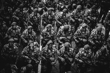 High Angle View Of Army Soldiers Holding Weapon At Parade