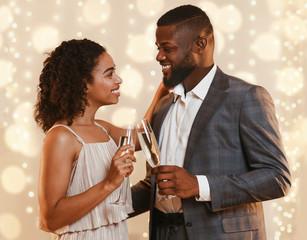 Beautiful black couple drinking champagne, having date