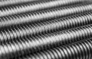 Bolts thread texture. Macro photo. Abstract background.