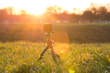 Action cam on a grass meadow filming beautiful dramatic sunset