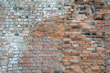 A brick wall collapses under natural conditions, in the open. Brick collapses from rain, wind and...