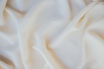 background texture of white and beige fabric